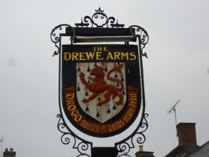 The lettering from a Home and Colonial shop front, on display at Castle Drogo, and the coat of arms outside the inn at Drewsteignton .